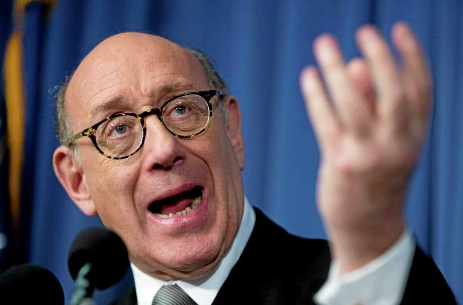 Kenneth Feinberg, the independent claims administrator for the General Motors Ignition Compensation Program, announces the details of the program, including eligibility, scope, rules for the program, and timing of submitting claims, during a news conference Monday at the National Press Club in Washington. Photo: Associated Press  / AP
