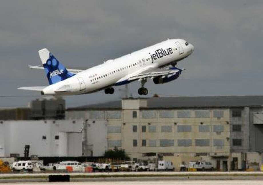 A JetBlue plane takes off Oct. 26, 2009 from Miami International Airport.