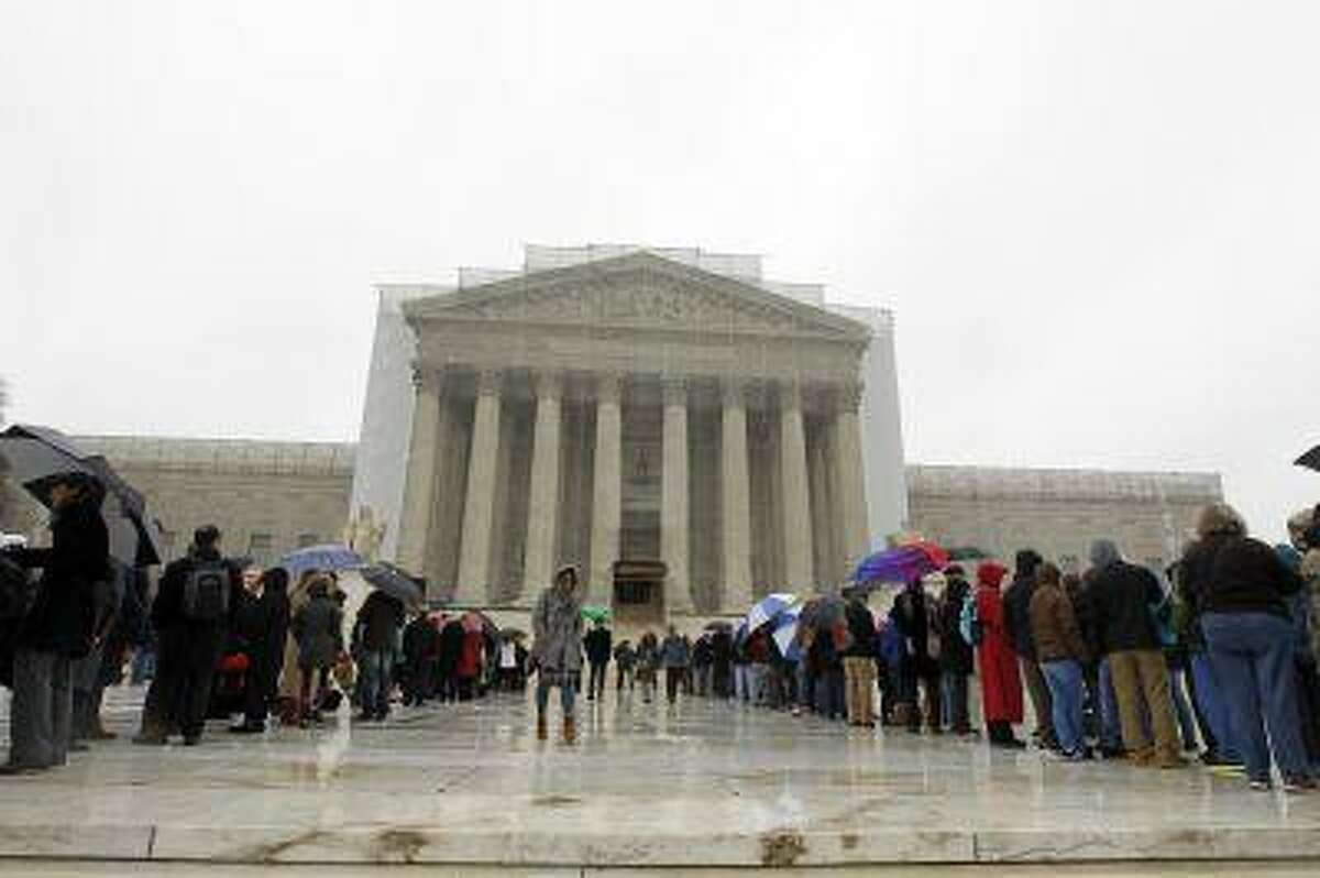 People wait to enter, outside of the U.S. Supreme Court, in Washington, on Monday March, 25, 2013, a day before the case for gay and lesbian couples rights, will be argued before the Supreme Court. (AP Photo/Jose Luis Magana)