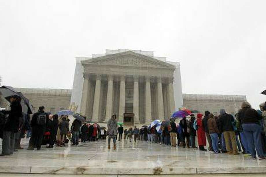 People wait to enter, outside of the U.S. Supreme Court, in Washington, on Monday March, 25, 2013, a day before the case for gay and lesbian couples rights, will be argued before the Supreme Court. (AP Photo/Jose Luis Magana) Photo: AP / FR159526 AP