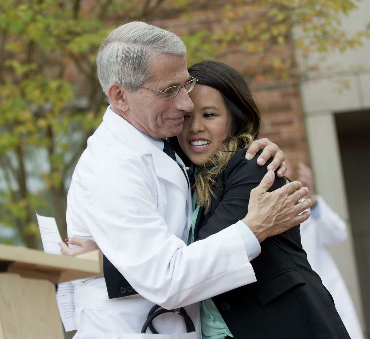 Patient Nina Pham is hugged by Dr. Anthony Fauci, director of the National Institute of Allergy and Infectious Diseases, outside of National Institutes of Health (NIH) in Bethesda, Md., Friday, Oct. 24, 2014. Pham, the first nurse diagnosed with Ebola after treating an infected man at a Dallas hospital is free of the virus. The 26-year-old Pham arrived last week at the NIH Clinical Center. She had been flown there from Texas Health Presbyterian Hospital Dallas. (AP Photo/Pablo Martinez Monsivais)