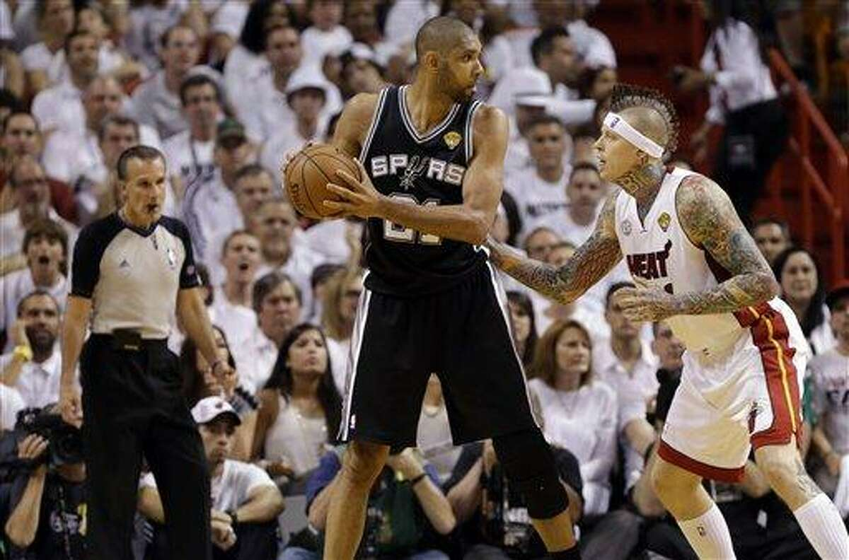 San Antonio Spurs' Tim Duncan, left, is defended by Miami Heat's Chris Andersen, right, during the second half of Game 2 of the NBA Finals basketball game, Sunday, June 9, 2013 in Miami. (AP Photo/Lynne Sladky)