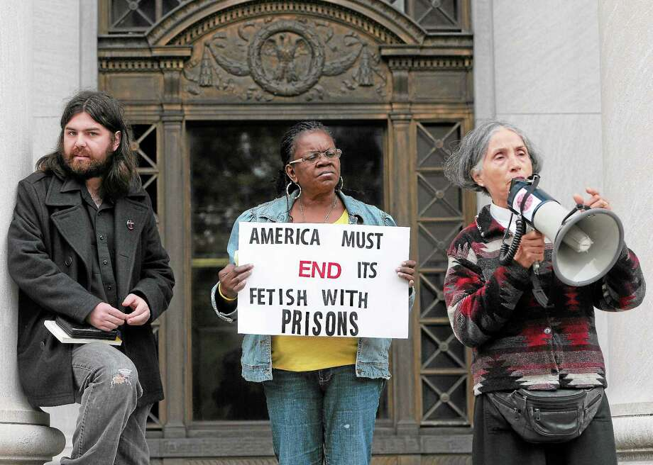 (Peter Hvizdak — Register)Greg Williams of the Yale Divinity School and the Seminarians for a Democratic Society, left, Barbara Fair, a New Haven community activist, center, and Valerie Dixon, an Episcopal priest at St. John's Church in Niantic and a volunteer at the York Correctional Institute, right, during  a protest Tuesday October 15, 2013 at the Federal Courthouse in New Haven against the transfer of women prisoners from the Danbury Federal Correctional Institute. Photo: New Haven Register / ©Peter Hvizdak /  New Haven Register