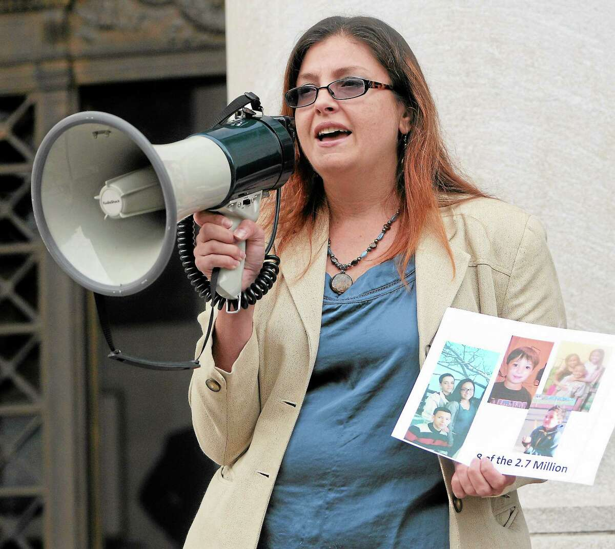 (Peter Hvizdak — Register)Tamara L. Petro, Executive Director of The Multicultural Leadership Institute Inc. in North Haven speaks during a protest Tuesday October 15, 2013 at the Federal Courthouse in New Haven against the transfer of women prisoners from the Danbury Federal Correctional Institute.