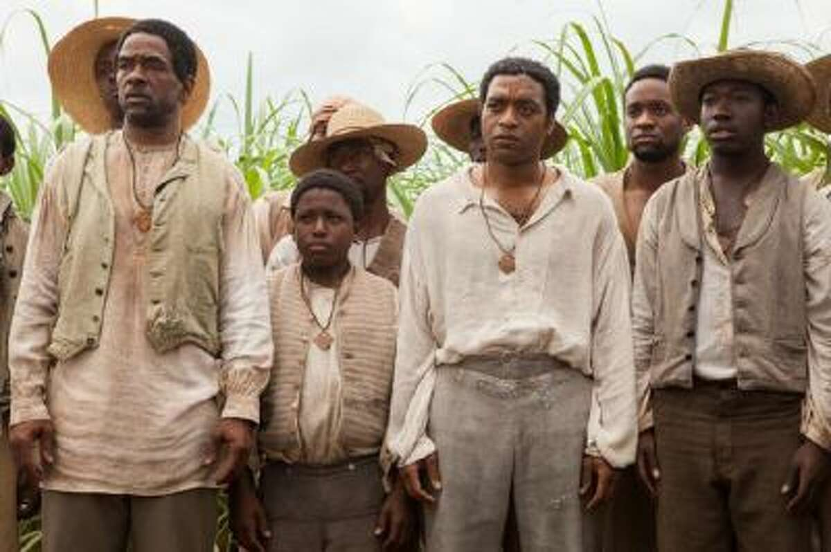 """Chiwetel Ejiofor as Solomon Northup, third from right, in """"12 Years A Slave."""""""