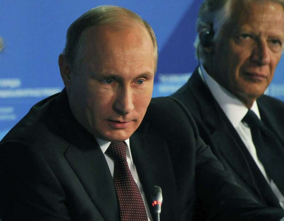Russian President Vladimir Putin speaks at a meeting of the Valdai International Discussion Club in the Black Sea resort of Sochi, Russia, Friday, Oct. 24, 2014. The United States is destabilizing the global world order by trying to enforce its will, Russian President Vladimir Putin declared Friday, warning that the world will face new wars if Washington fails to respect the interests of other countries. (AP Photo/RIA-Novosti, Mikhail Klimentyev, Presidential Press Service) Photo: AP / RIA Novosti Kremlin