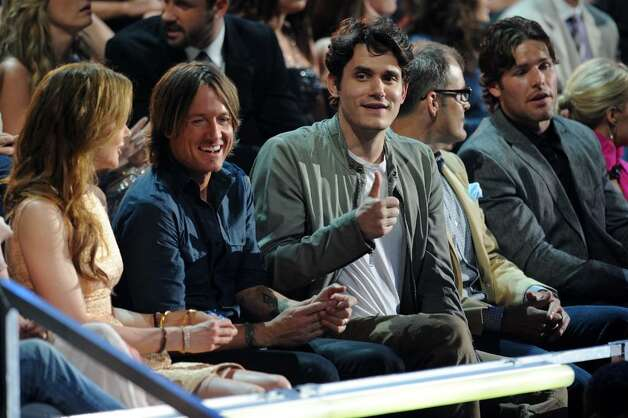 NASHVILLE, TN - JUNE 09:  (L-R) Nicole Kidman, Keith Urban and John Mayer attend the 2010 CMT Music Awards at the Bridgestone Arena on June 9, 2010 in Nashville, Tennessee.  (Photo by Jason Merritt/Getty Images) *** Local Caption *** Nicole Kidman;Keith Urban;John Mayer Photo: Jason Merritt, Getty Images / 2010 Getty Images