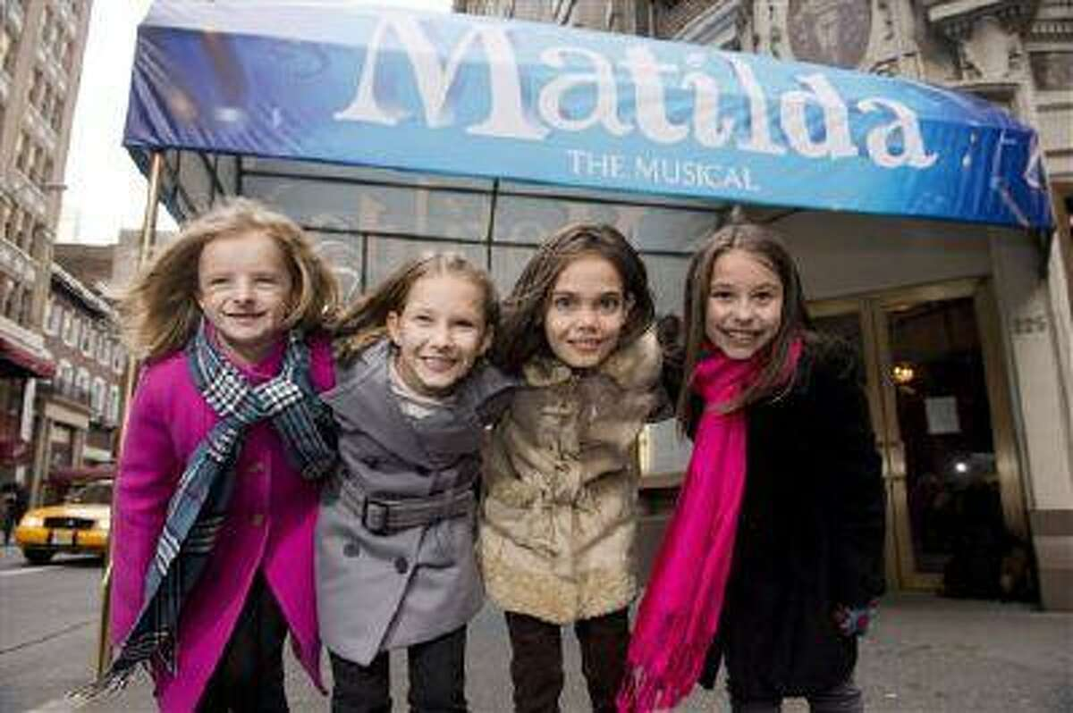 """From left, Milly Shapiro, Sophia Gennusa, Oona Laurence and Bailey Ryon pose for a portrait outside the Shubert Theatre in New York. The four young actresses share the title role in """"Matilda the Musical"""" on Broadway. (Photo by Charles Sykes/Invision/AP, file)"""