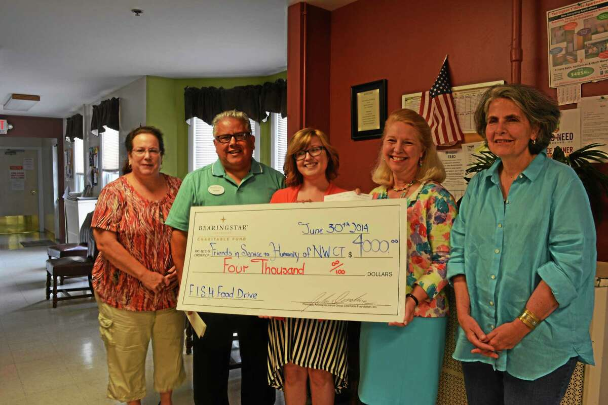 Lou Servin presents Deirdre DiCara with a check for $4,000. (left to right) Margaret Franzi, food pantry manager at FISH; Lou Servin, insurance consultant for Bearingstar; Cheryl O'Shea, from Bearingstar; Deirdre DiCara, and Charlene Goodman Dutka, Ciesco Catering.