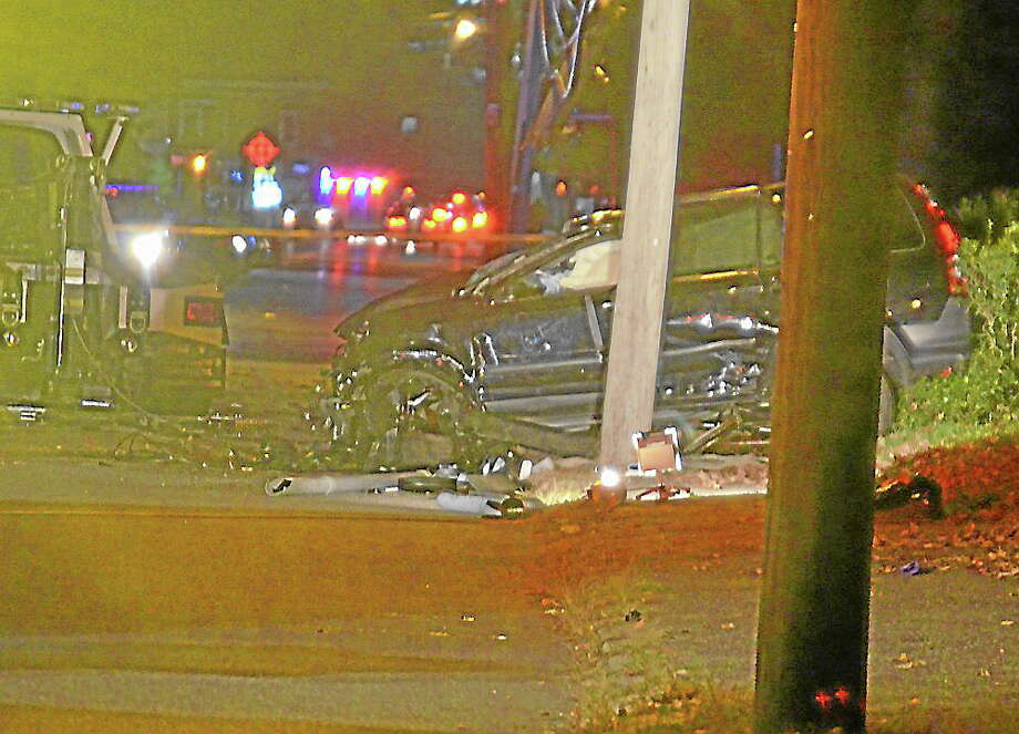 Tom Cleary-Register CitizenA Honda CRV was flipped by firefighters after rolling over during an accident on Migeon Avenue in Torrington on Oct. 15, 2013. Photo: Journal Register Co.