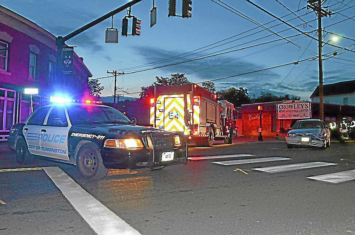 Tom Caprood-Register CitizenThe scene of a car crash at the intersection of Water and Church streets in Torrington on Oct. 15, 2013.