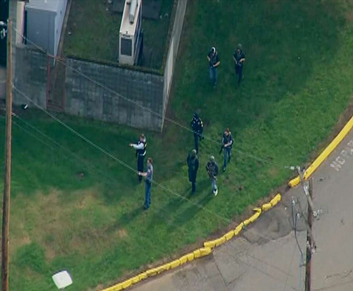 This image made from a video provided by KOMO shows emergency personnel responding after reports of a shooting at Marysville-Pilchuck High School in Marysville, Wash., Friday.