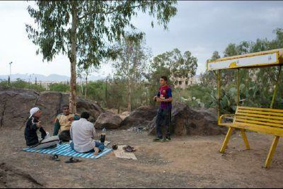 Egyptian tourists enjoy an afternoon picnic at the Sana'a Zoo in Yemen. As one of the few green spaces among the city's urban sprawl, the zoo is a weekend and holiday destination for Yemenis looking for an afternoon of entertainment. (Juan Herrero/GlobalPost)