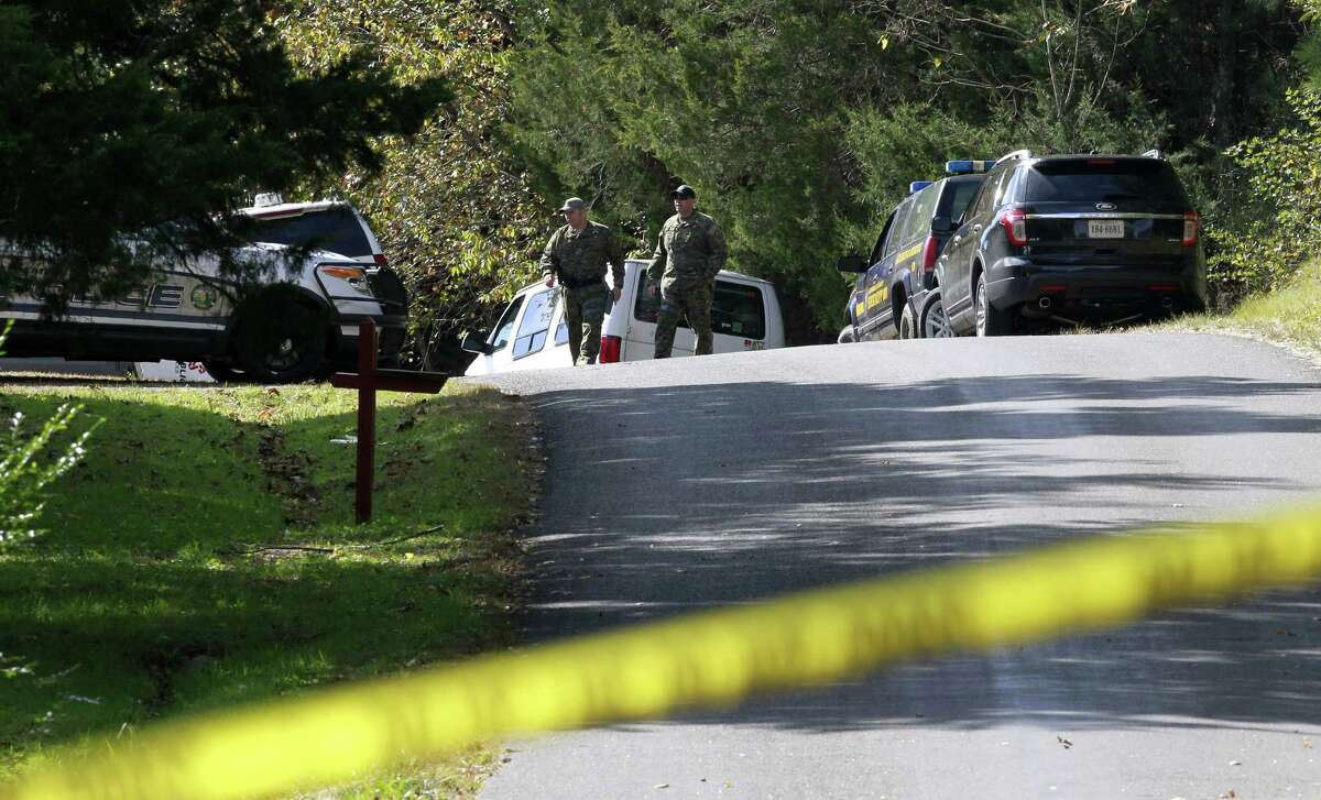 Law enforcement investigators continue to search for evidence where human remains were recently discovered in Albemarle County, Va., Monday, Oct. 20, 2014. Police blocked off roads, sifted through leaves and scoured a rural area where they found remains that could be missing University of Virginia student Hannah Graham.