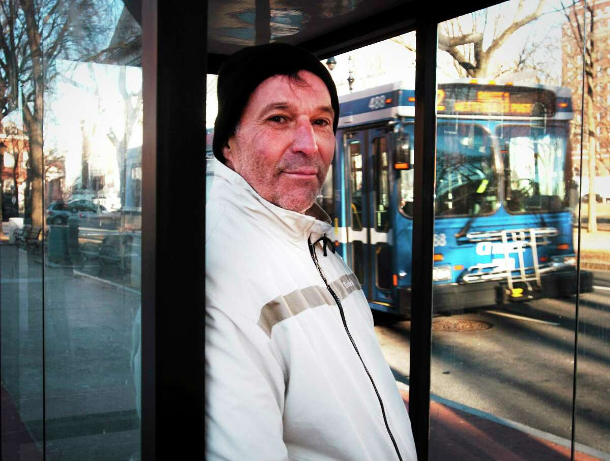 Ed Avery at the bus stop on Temple Street. He takes the bus to work at Walmart.