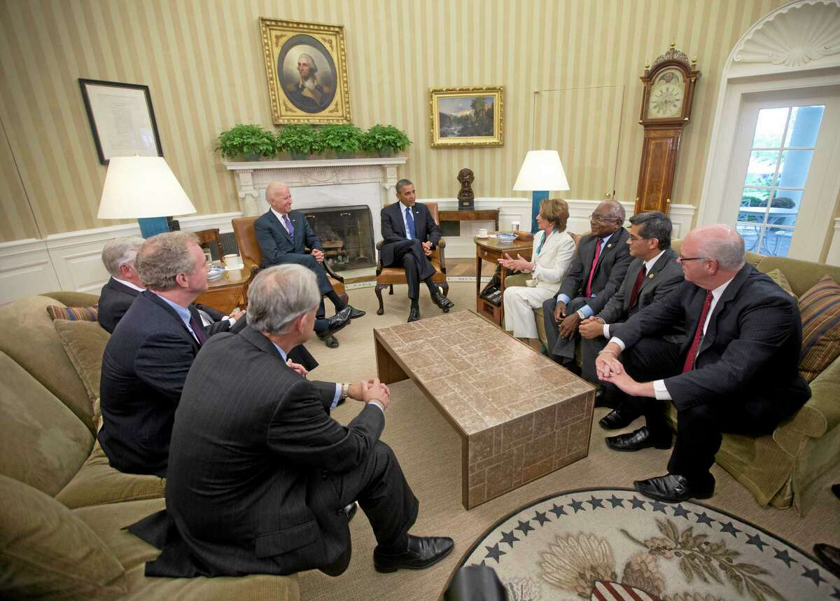 President Barack Obama, center, and Vice President Joe Biden, center left, meet with Democratic Leadership in the Oval Office of the White House, Tuesday, Oct. 15, 2013, in Washington. Sitting with them clockwise from the bottom left, Rep. Steve Israel, D-N.Y., Rep. Chris Van Hollen, D-Md., Rep. Steny Hoyer, Md., House Minority Leader Nancy Pelosi of Calif., Rep. James Clyburn, D-S.C., Rep. Xavier Becerra, D-Calif., Rep. Joseph Crowley, D-N.Y. The partial government shutdown is in its third week and less than two days before the Treasury Department says it will be unable to borrow and will rely on a cash cushion to pay the country's bills. (AP Photo/Pablo Martinez Monsivais)