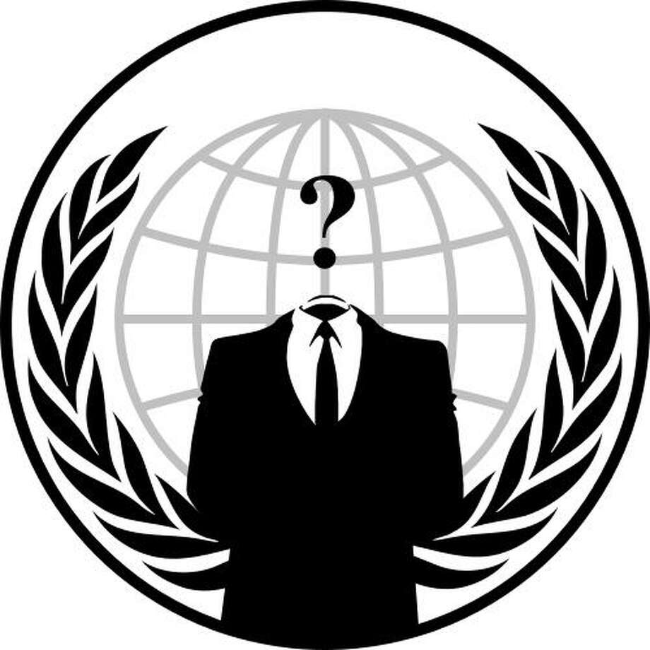 "(Photo by Wikimedia Commons) - An image commonly associated with Anonymous. The ""suit without a head"" represents leaderless organization and anonymity."