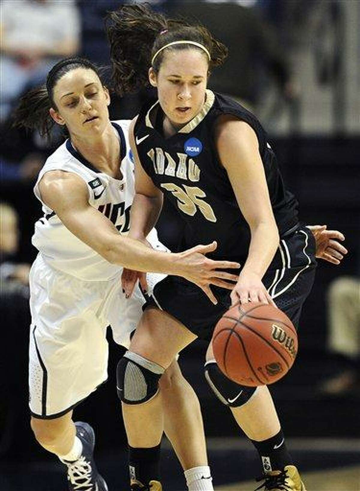 Connecticut's Kelly Faris, left, pressures Idaho's Connie Ballestero, right, in the first half of a first-round game in the women's NCAA college basketball tournament in Storrs, Conn., Saturday, March 23, 2013. (AP Photo/Jessica Hill)