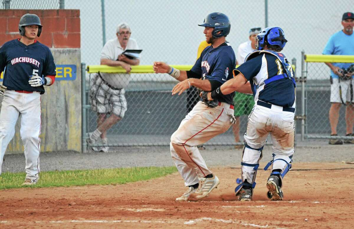 Torrington Titans' catcher James DeNomme tags out the Dirt Dawgs' Tony Rallo who was trying the score.