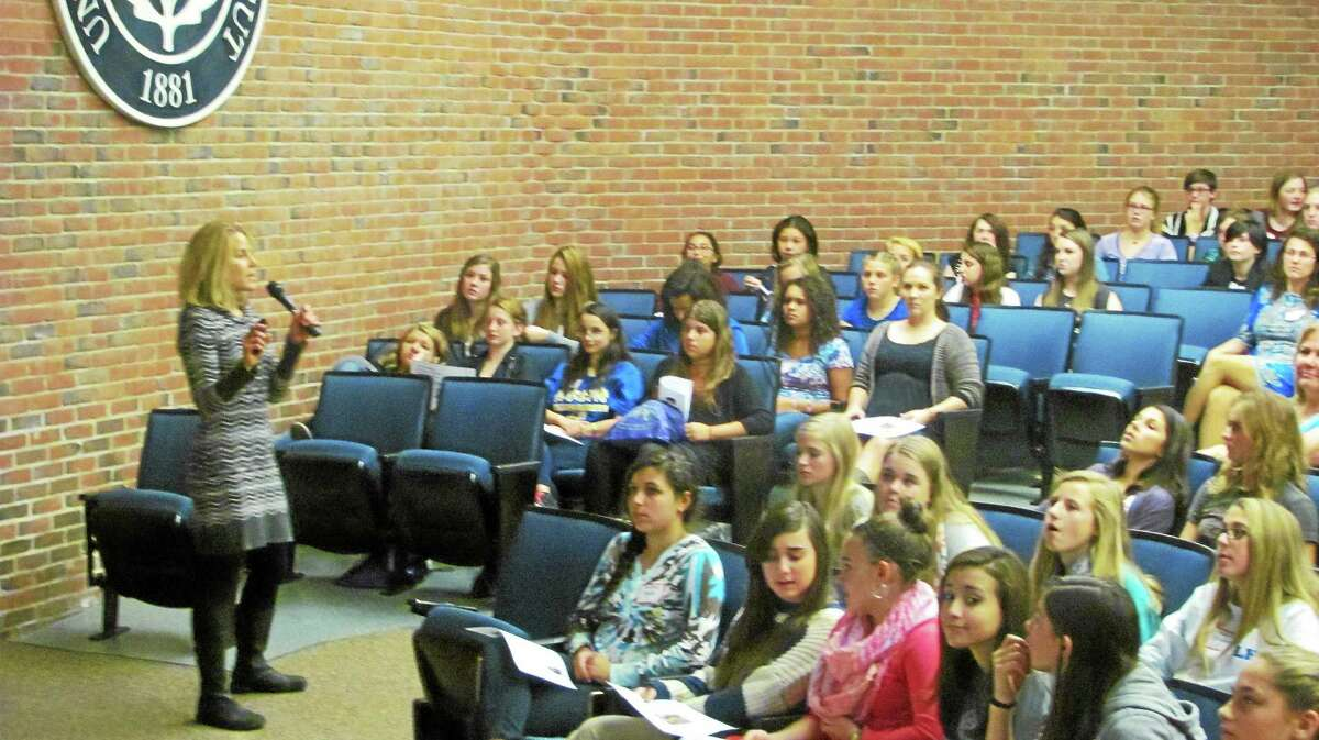 Carla Angevine, a nutritionist from Charlotte Hungerford Hospital, speaks to a crowd of area girls at UConn Torrington Friday during the United Way of Northwest Connecticut's Girls Summit.