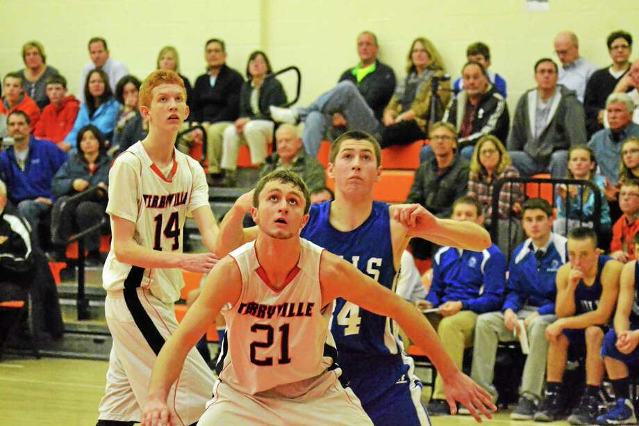 Terryville's Jake Johnson boxes out Lewis Mills' Ben Lewis in the Kangaroos 70-45 win. Johnson scored 18 points. Photo: Pete Paguaga — Register Citizen