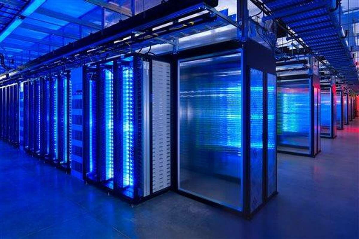 This undated photo provided by Facebook shows the server room at the company's data center in Prineville, Ore. The revelations that the National Security Agency is perusing millions of U.S. customer phone records at Verizon and snooping on the digital communications stored by nine major Internet services illustrate how aggressively personal data is being collected and analyzed. (AP Photo/Facebook, Alan Brandt)