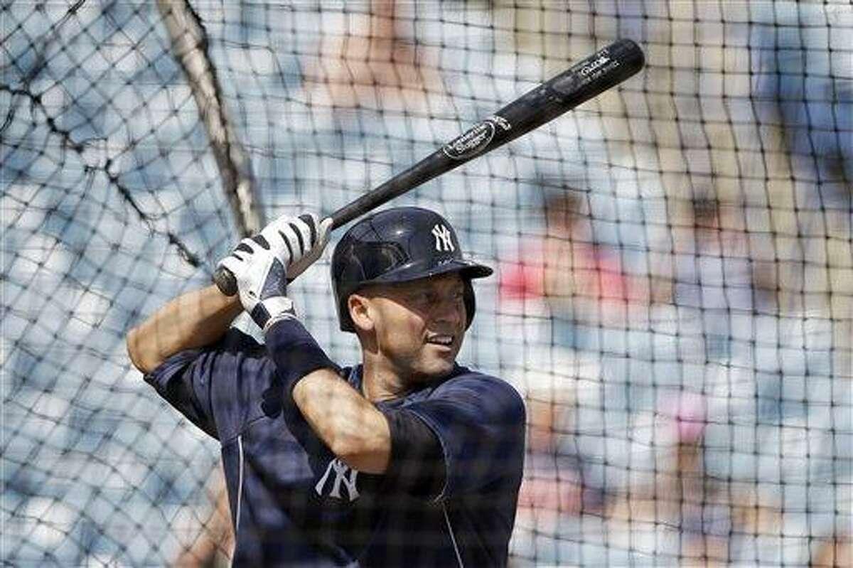 New York Yankees' Derek Jeter takes batting practice during a workout at baseball spring training, Wednesday, Feb. 20, 2013, in Tampa, Fla. (AP Photo/Matt Slocum)