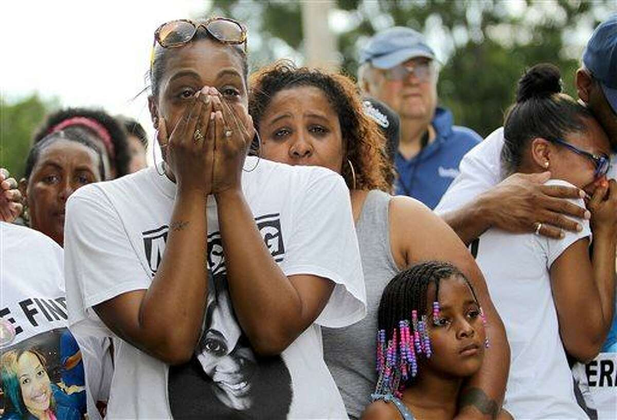 Family members of teacher Terrilynn Monette, who has been missing since leaving a nearby bar in early March, react as her car is pulled from Bayou St. John by the Harrison Avenue Bridge in New Orleans on Saturday, June 8, 2013. (AP Photo/The Times-Picayune, Michael DeMocker) MAGS OUT; NO SALES; USA TODAY OUT; THE BATON ROUGE ADVOCATE OUT