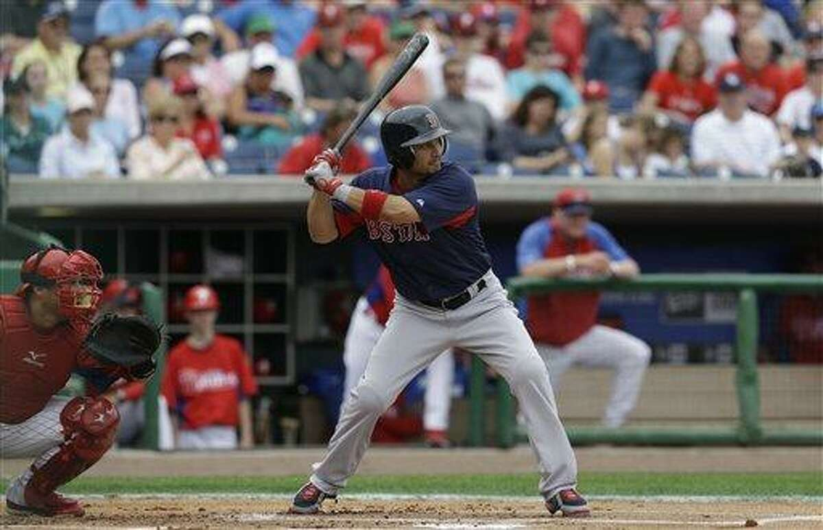 Boston Red Sox Shane Victorino bats against Phillies starter Cliff Lee in a spring training baseball game in Clearwater, Fla., Sunday, March 24, 2013. (AP Photo/Kathy Willens)