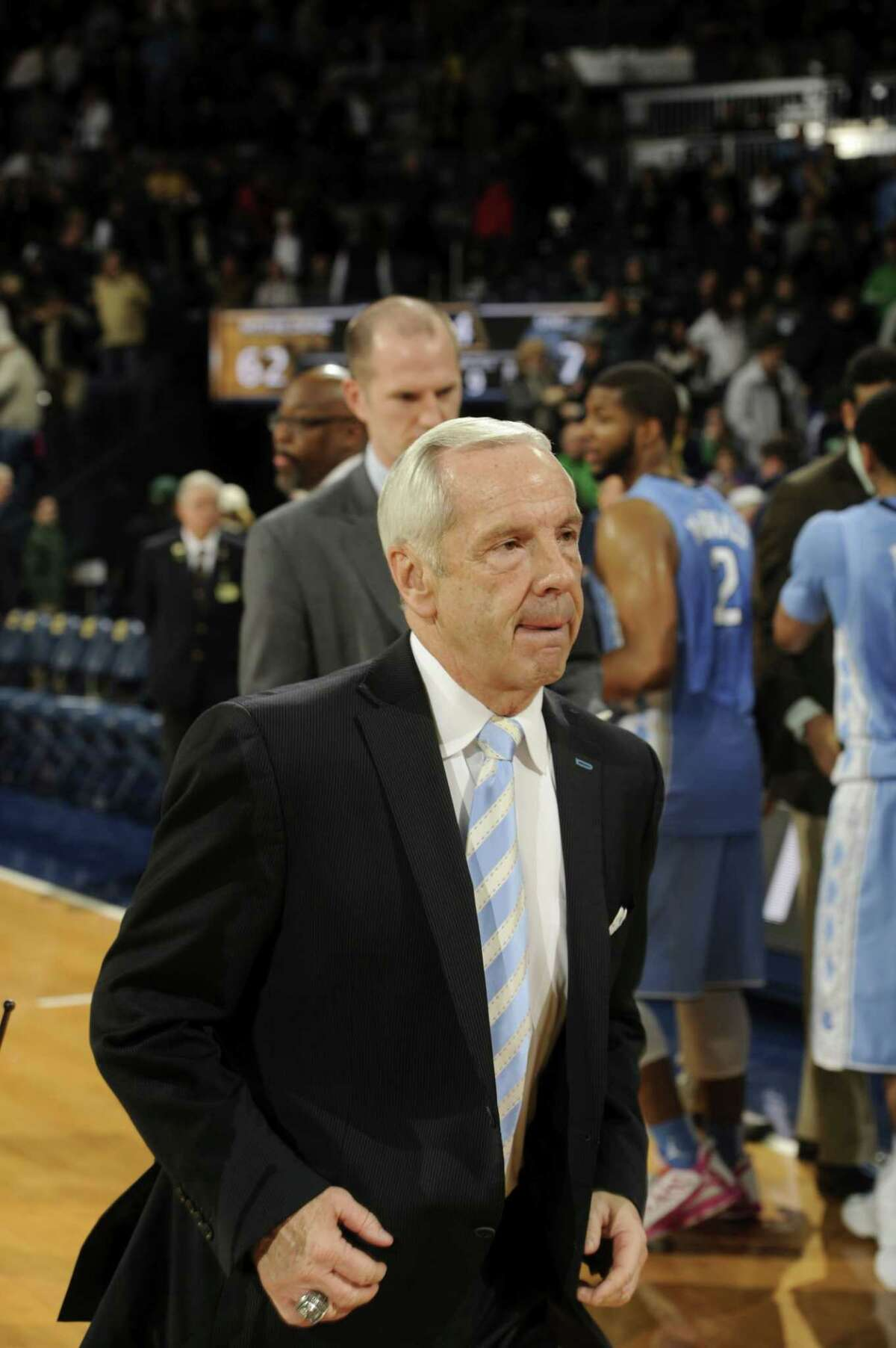 North Carolina coach Roy Williams runs off the court after a Feb. 8 game in South Bend, Ind.