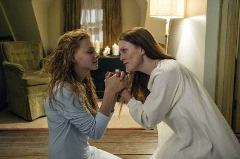 Chloe Moretz as Carrie White (left) and Julianne Moore as Margaret White in 'Carrie' / © 2012 Metro-Goldwyn-Mayer Pictures Inc. and Screen Gems, Inc.  All rights reserved.  **ALL IMAGES ARE PROPERTY OF SONY PICTURE