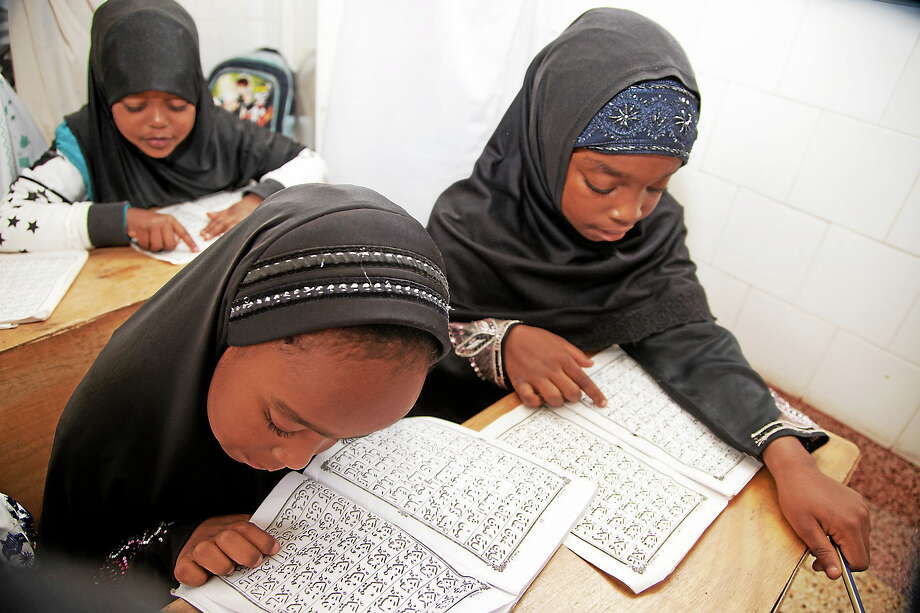 Children recite the Quran at the start of Muslim holy month of Ramadan at a madrassa, or Islamic school in Nairobi, Kenya on June 29, 2014. Photo: AP Photo/Sayyid Azim  / AP