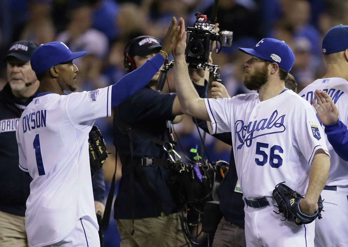 Kansas City outfielder Jarrod Dyson (1) high fives with Greg Holland after the Royals' 7-2 victory over the San Francisco Giants in Game 2 of the World Series on Wednesday in Kansas City, Mo.
