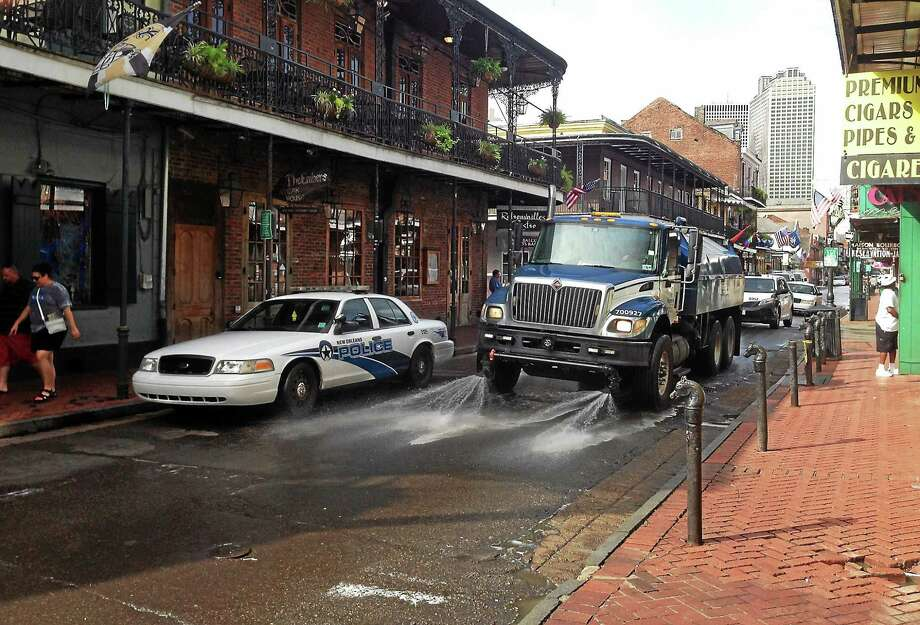 A Progressive Waste Solutions truck sprays along Bourbon Street, following a shooting earlier in the day on June 29, 2014, in New Orleans. Photo: AP Photo/NOLA.com/The Times-Picayune, Benjamin Alexander-Bloch  / NOLA.com-The Times-Picayune