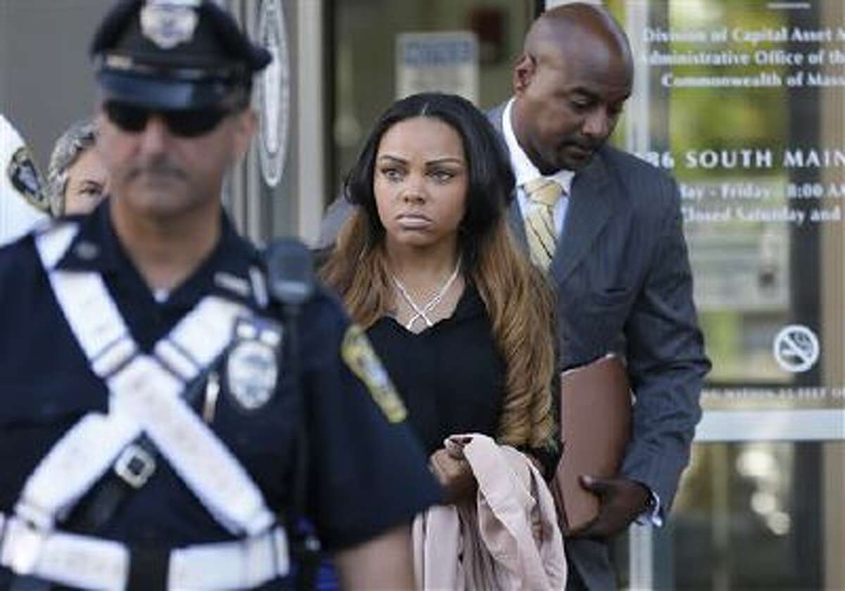 ShayannaJenkins, center, girlfriend of former New England Patriots' Aaron Hernandez, departs superior court, in Fall River, Mass., Tuesday, Oct. 15, 2013, following her arraignment on a perjury charge in connection with the killing of Hernandez's friend. Authorities say Jenkins, 24, was untruthful in her testimony before the grand jury investigating the death of Odin Lloyd.
