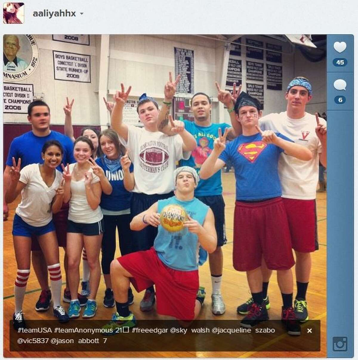 """Screenshot from Instagram. An image posted to the social photo sharing site Instagram on March 22, 2013, shows students in the Torrington High School gymnasium flashing a hand gesture for Edgar Gonzalez's football jersey number, """"21."""" The image also carried the hashtag """"FreeEdgar."""" Based on the pictured """"2013 Champions"""" dodgeball, the photo was likely taken following the dodgeball tournament held earlier that evening."""