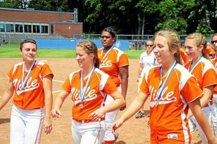 Photo by Sean Meenaghan The Terryville Kangaroos wearing their second place medals walk to the plate to pick up their Class S state championship second place plaque.