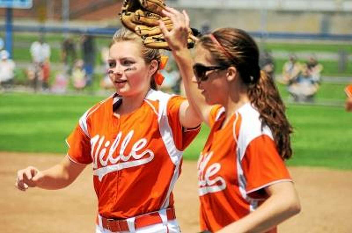 Photo by Sean Meenaghan Terryville second baseman Angel Katiewicz (left) celebrates with Terryville first baseman Kristina Hull after getting an out. Oxford defeated Terryville 1-0.