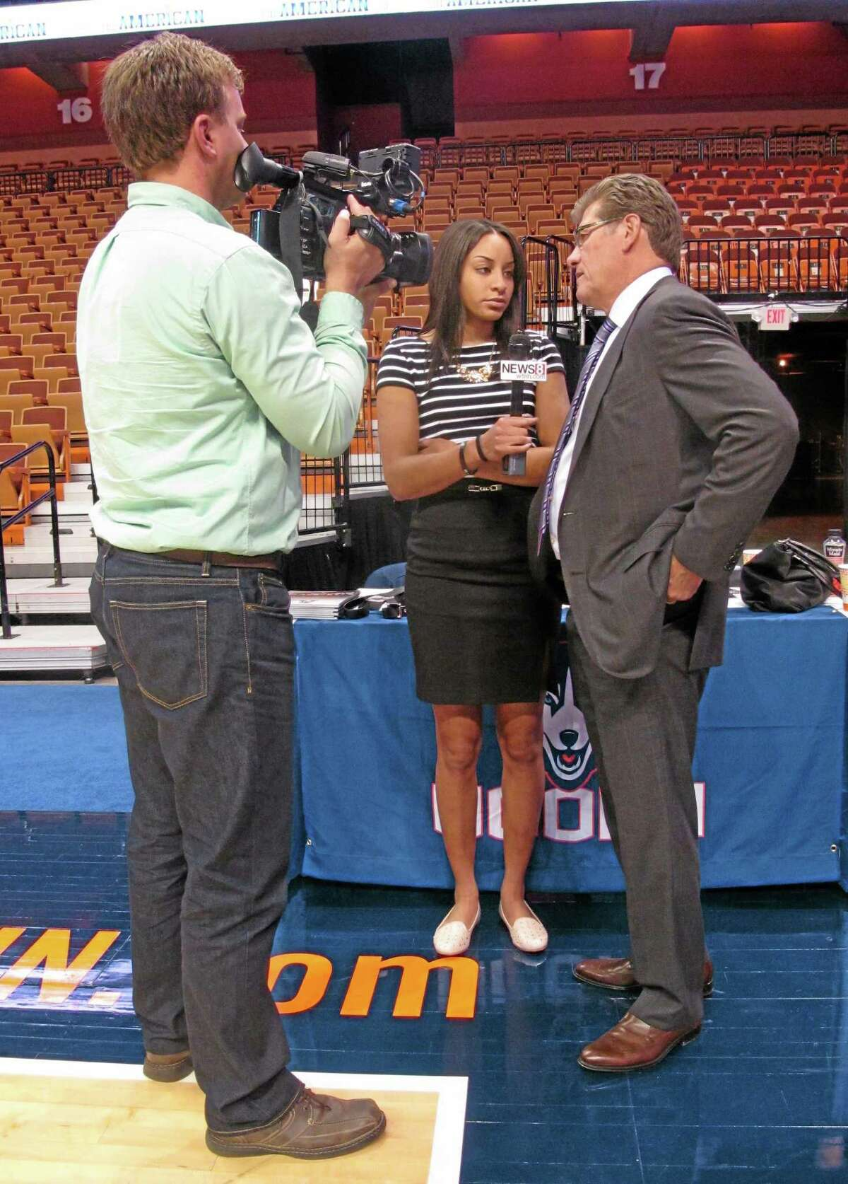 UConn guard Bria Hartley, center, plays interviewer with coach Geno Auriemma, right, during the American Athletic Conference's women's basketball media day on Monday at the Mohegan Sun Arena in Uncasville, Conn.
