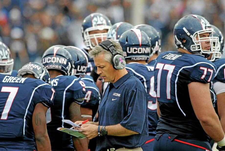 UConn interim head coach T.J. Weist. Photo: Fred Beckham — The Associated Press  / FR153656 AP