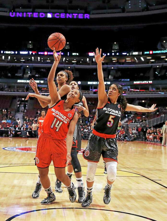Sadie Edwards, left, gets her shot off between Brianna Turner, background, and Recee Caldwell during the McDonald's All-American game in April in Chicago. Photo: Charles Rex Arbogast — The Associated Press File Photo  / AP