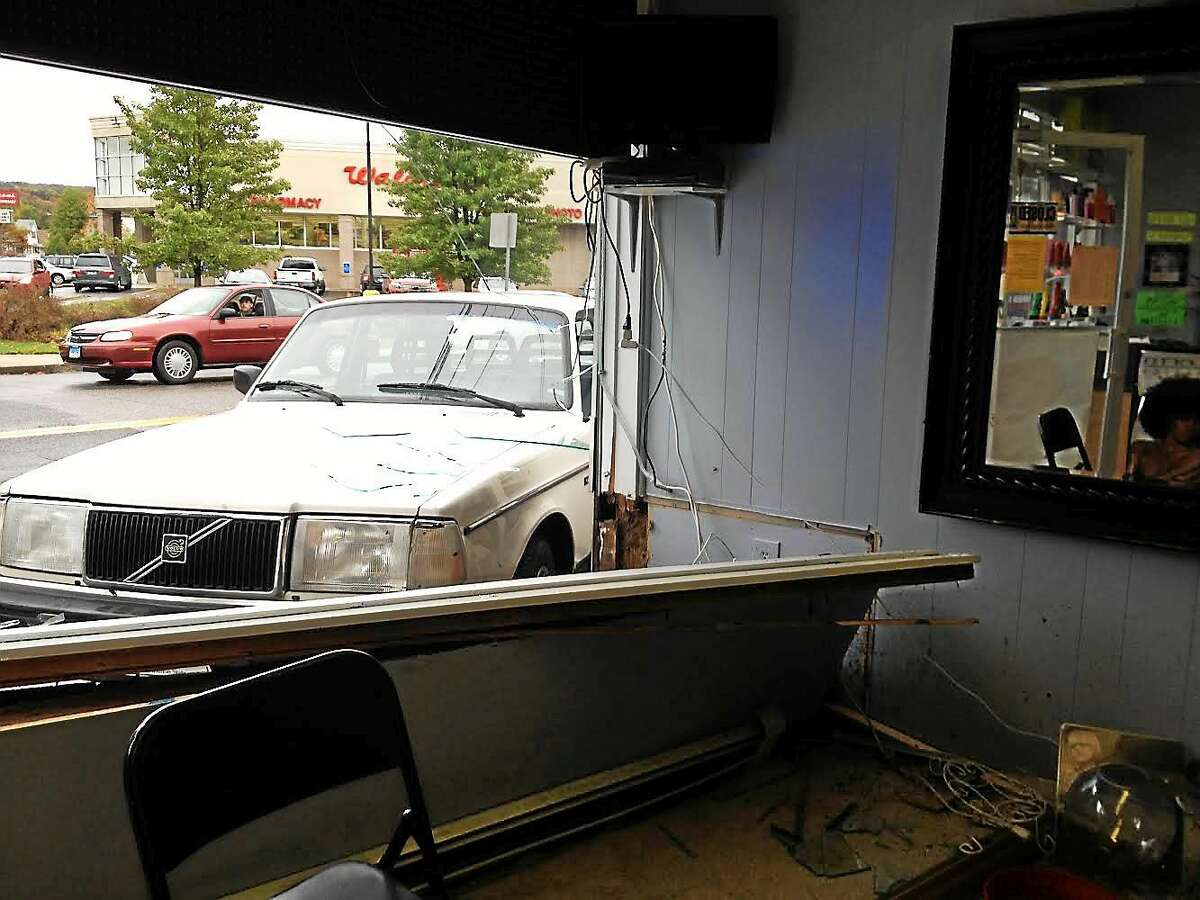 The scene of an accident which involved a car crashing into Anthony's Barber Shop from inside the salon on Main Street Thursday in Torrington.