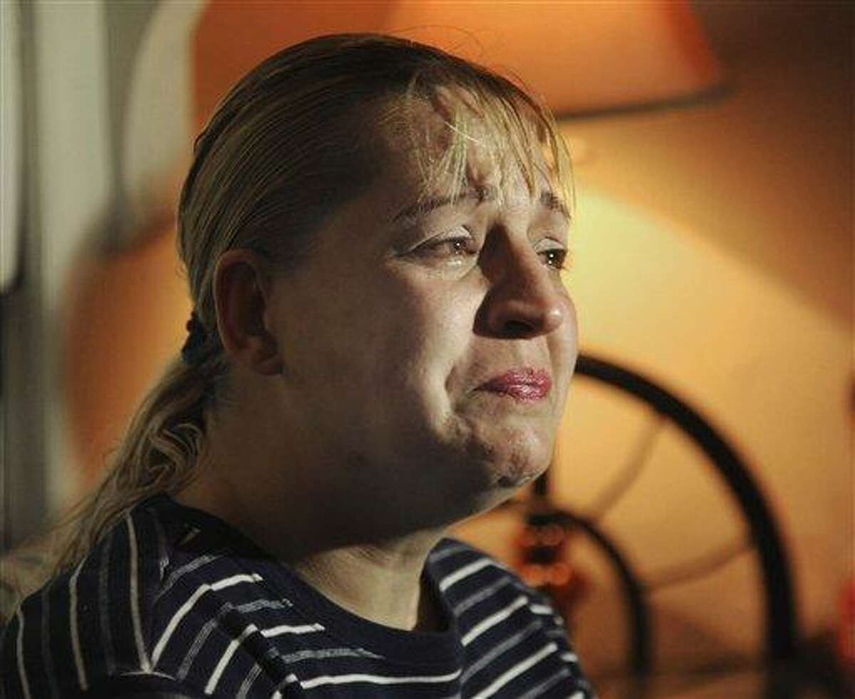 """Sherry West breaks down in tears as she describes the incident the day before where her 13-month-old son was fatally shot and she was wounded Friday, March 22, 2013 in Brunswick, Ga. West said Friday a teenager trying to rob her at gunpoint asked """"Do you want me to kill your baby?"""" before he fatally shot her 13-month-old son in the head. (AP Photo/The Brunswick News, Bobby Haven)"""