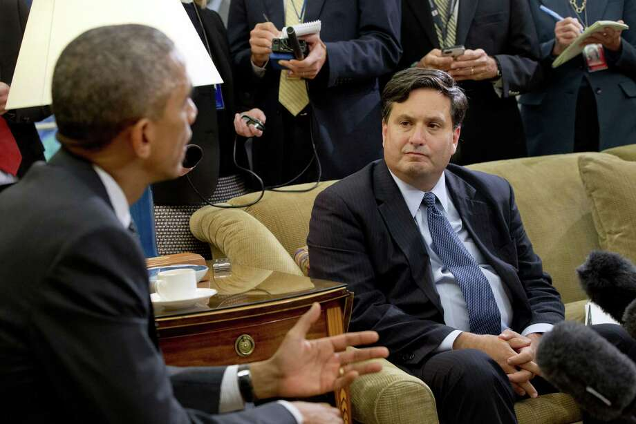 As reporters take notes, Ebola coordinator Ron Klain listens to President Barack Obama as he speaks to the media about the governmentís Ebola response in the Oval Office of the White House, Wednesday, Oct. 22, 2014, in Washington. (AP Photo/Jacquelyn Martin) Photo: AP / AP