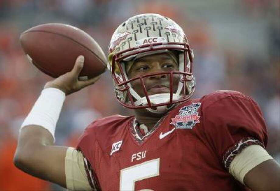 This Jan. 6, 2014 file photo shows Florida State quarterback Jameis Winston warming up before the NCAA BCS National Championship game.