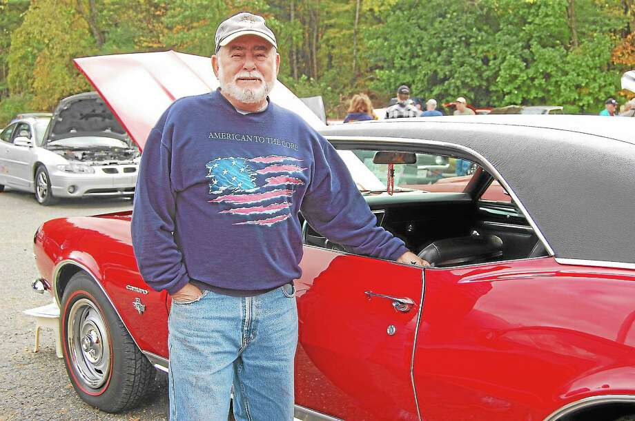 Tom Carta, of Middlefield, shows of his red 1967 Chevrolet Camaro at the New Hartford Volunteer Fire and Rescue Department's Cartoberfest event at Collinsville Antiques on Sunday. Photo: Photos By Mercy Quaye — Register Citizen