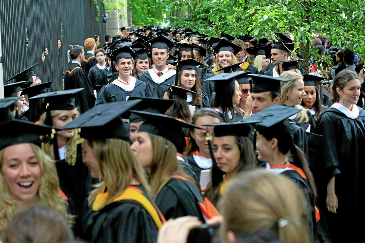 In this Tuesday, June 5, 2012 photo, friends and family greet a procession of the graduating class of 2012 at Princeton University after commencement ceremonies in Princeton, N.J.