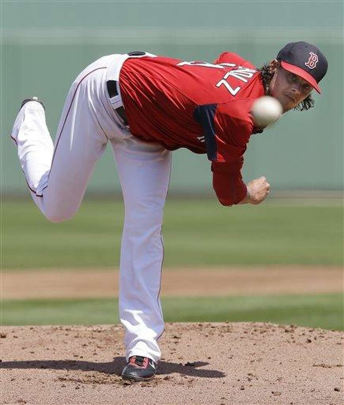 Boston Red Sox starting pitcher Clay Buchholz delivers to the Pittsburgh Pirates in the first inning of an exhibition spring training baseball game in Fort Myers, Fla., Saturday, March 23, 2013. (AP Photo/Elise Amendola)
