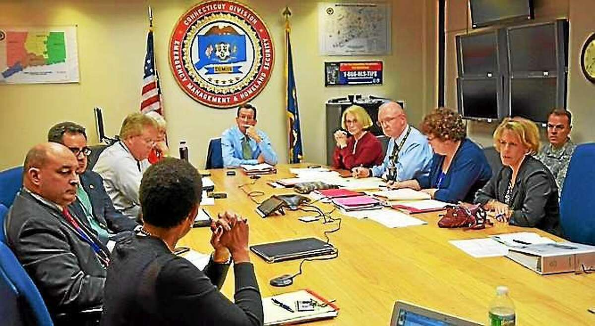 Gov. Dannel P. Malloy and other state officials are briefed by Department of Public Health Commissioner Jewel Mullen on the state's response to Ebola Oct. 15 in Hartford. Contributed photo.