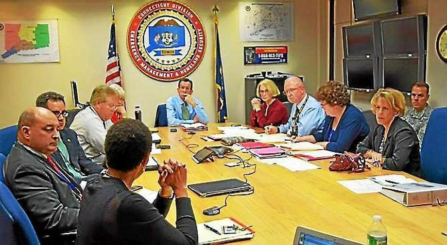 Gov. Dannel P. Malloy and other state officials are briefed by Department of Public Health Commissioner Jewel Mullen on the state's response to Ebola Oct. 15 in Hartford. Contributed photo. Photo: Journal Register Co.